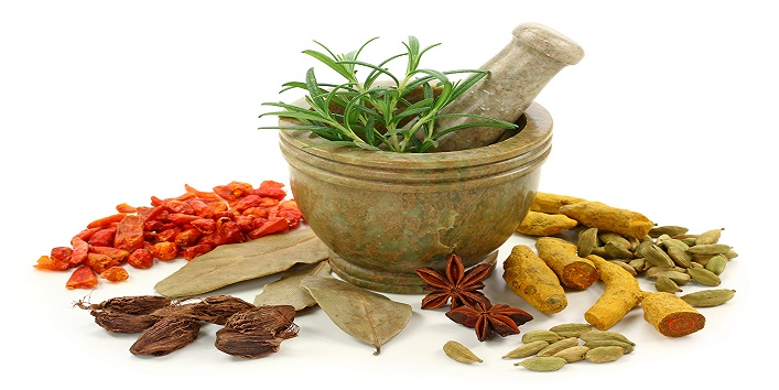 Mortar with fresh rosemary and dried spices