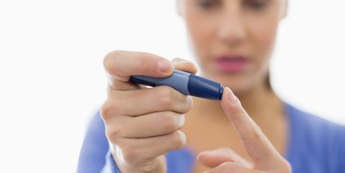 Woman taking her own blood sugar
