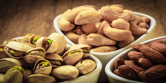 Healthy food and cuisine. Varieties of nuts: cashew, pistachio, almond